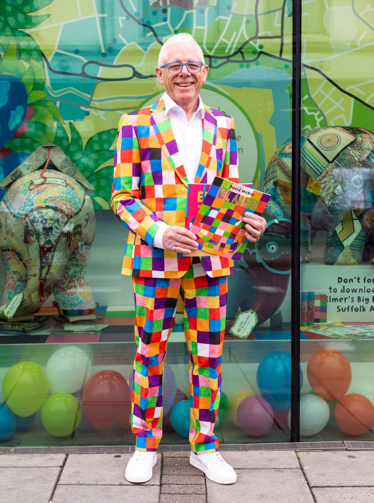Norman wearing the Coes Made to Measure Elmer suit at the launch of Elmer's Big Parade Suffolk